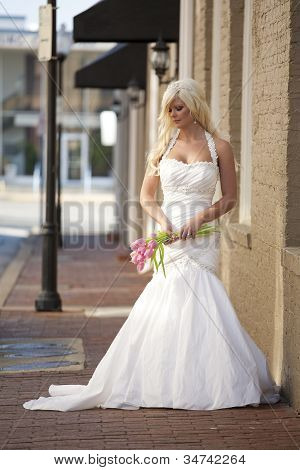 Bride Posing on a Brick Sidewalk