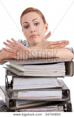 Business Woman In Office Looks At Unbelievable Folder Stack