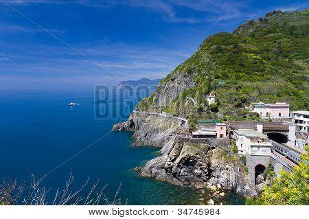 Coastline at Riomaggiore and railway station, Cinque Terre, Italy