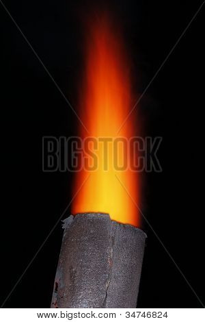 Red torch over metal chimney