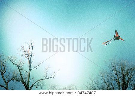 Kite soaring above trees