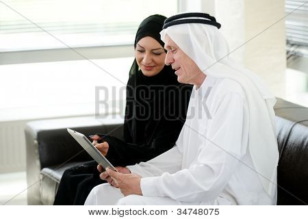 Muslim Arabic couple together indoors