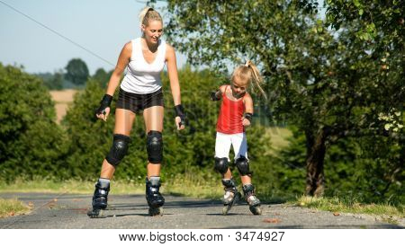Mother And Daughter Skating