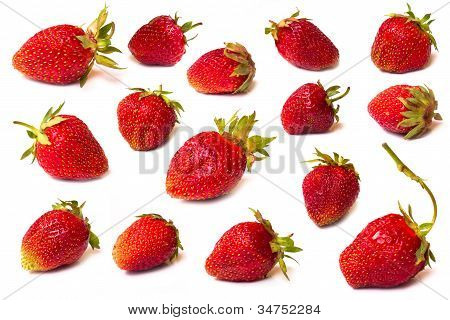 The fresh cut strawberries set on a white