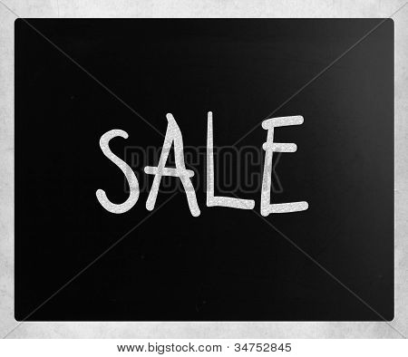 """sale"" Handwritten With White Chalk On A Blackboard"