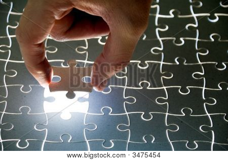 Puzzle And Hand