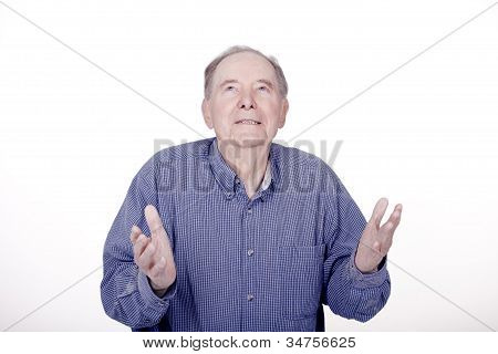 Elderly Man Looking Up With Expectant Look