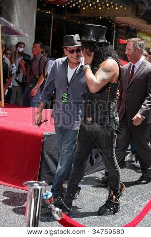 LOS ANGELES - JUL 9:  Charlie Sheen, Slash at the Hollywood Walk of Fame Ceremony for Slash at Hard Rock Cafe at Hollywood & Highland on July 9, 2012 in Los Angeles, CA