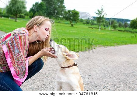 Woman Playing  With Puppy Outdoor