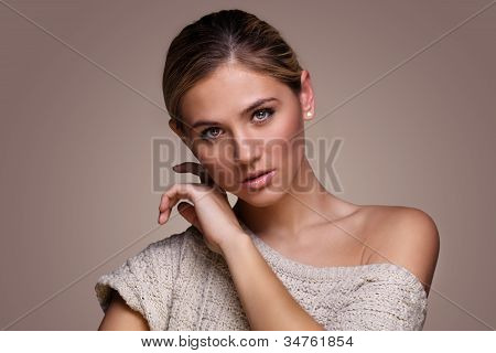Beautiful happy young woman in sweater