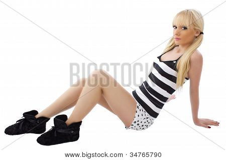 Pretty Smiling Woman Sitting Isolated Over White