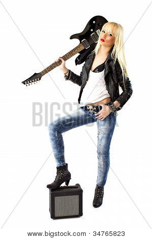 Sexy Blonde Woman In Blue Jeans Posing With Black Electric Guitar
