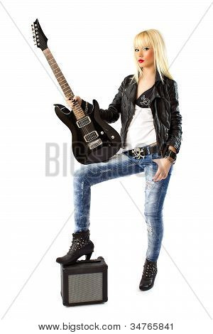 Beautiful Blonde Woman In Blue Jeans Posing With Black Electric Guitar
