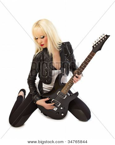 Beautiful Blonde Girl In Black Leather Jacket Posing With Black Electric Guitar