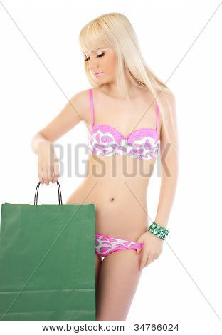Lovely Blonde Woman With Shopping Bag Over White