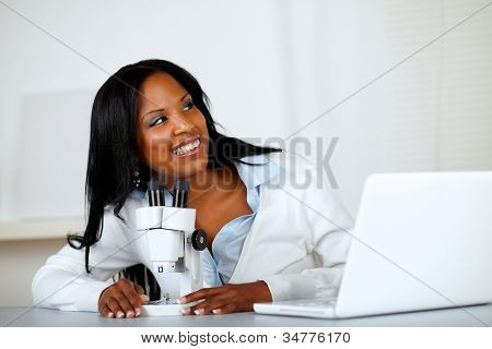 Pretty Young Woman Using A Microscope