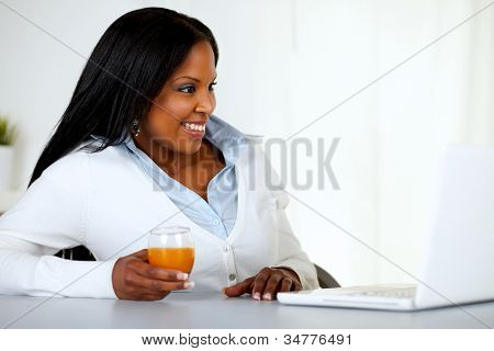 Pretty Young Woman Looking Having Fun On Laptop