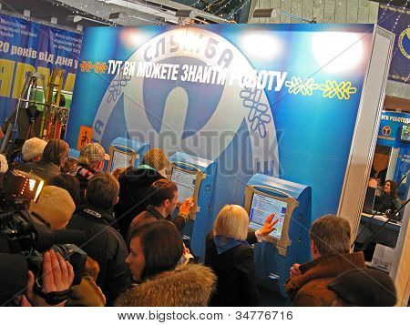 KIEV-DECEMBER 21:People looking for job with computers during employment fair on December 21,2010