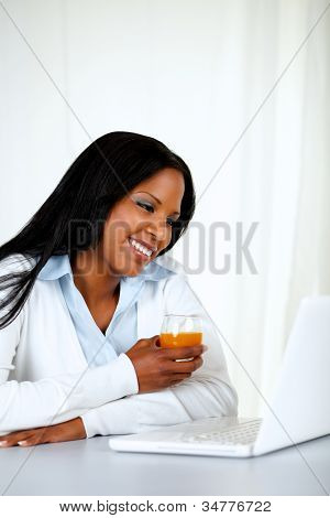 Attractive Female Reading Something On Laptop