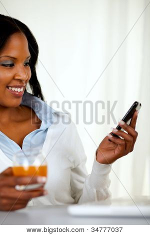 Young Woman Sending A Message By Cellphone