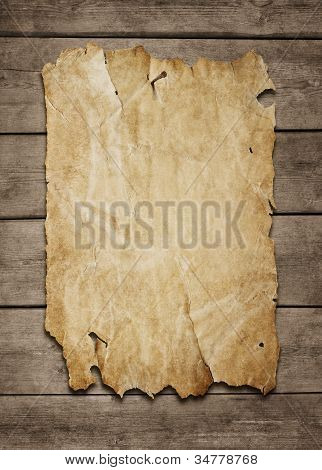 Old Paper Sheet At Wooden Wall