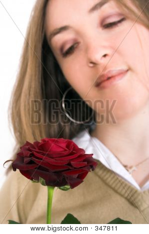 Beautiful Girl Looking At Rose - Focus On Rose