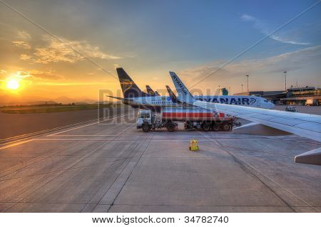 BERGAMO - JUNE 06:Ryanair airplanes on the parking and beautiful sunrise on background at Orio al Serio International Airport.Ryanair is world leader low cost company in Bergamo,Italy on June 06,2012.