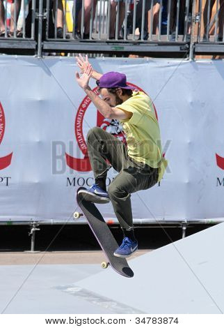 MOSCOW, RUSSIA - JULY 8: Pavel Kuznetsov in skateboarding competition during Adrenalin Games in Moscow, Russia on July 8, 2012