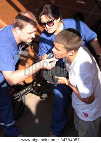 MOSCOW, RUSSIA - JULY 8: Doctors help to traumatized Tomas Stejskal, Czech Republic, during Adrenalin Games in Moscow, Russia on July 8, 2012