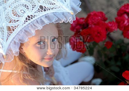 Girl Looks Out From Under The Lace Parasol