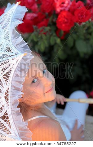 Smiling Girl Peeks Out From Under The Lace Parasol