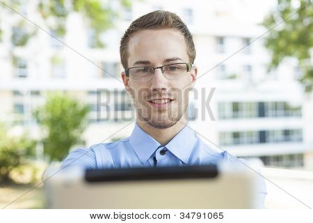 Businessman With Tablet Computer In Park