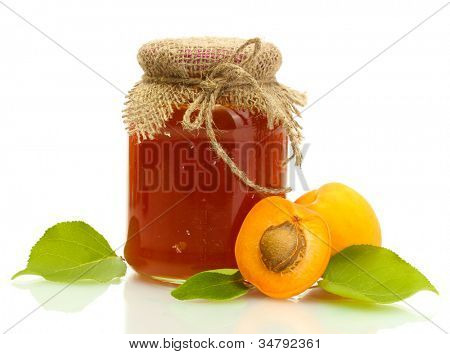 Apricot jam in a jar and sweet apricots isolated on white