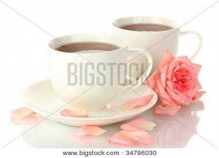 cups of tea with rose isolated on white