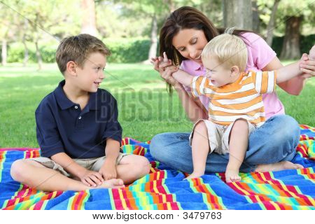 Mother And Sons Playing In Park