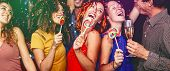 Happy Friends Celebrating New Year Eve Drinking Champagne In Nightclub - Young People Having Fun Dan poster