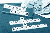 pic of workplace safety  - Injury claim concept with key words and cash compensation - JPG