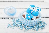 stock photo of mary jane  - Blue cupcake with baby shoes and comforter - JPG