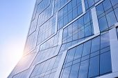 Modern Architecture With Sun Ray. Glass Facade On A Bright Sunny Day With Sunbeams In The Blue Sky. poster