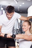 stock photo of personal trainer  - Woman exercising with personal trainer - JPG
