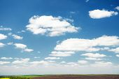 Azure sky background with white fluffy clouds in the fresh sunny day. Template textured sky backgrou poster
