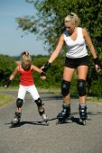 picture of roller-skating  - Mother helping her daughter learning to skate - JPG