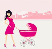 pic of pregnant woman  - beautiful pregnant woman pushing a stroller  - JPG