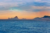 Ibiza sunset Es Vedra in Balearic islands view from Mediterranean sea