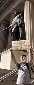 NEW YORK-JULY 11: An Occupy Guitarmy protester holds a sign that reads 'Angry Pacifist' in front of