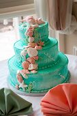 foto of three tier  - A blue beach themed wedding cake with three tiers - JPG