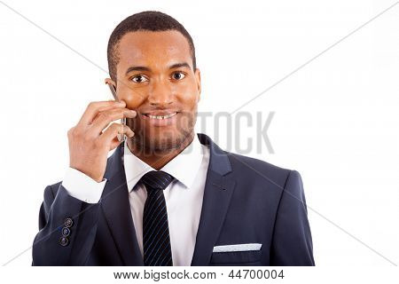 Closeup portrait of a handsome young business man speaking on the mobile isolated on white background
