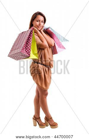 Happy lovely woman with shopping bags over white background