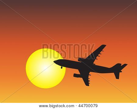 A concept or conceptual black plane,airplane aircraft silhouette flying over sky at sunset,sunrise background,metaphor to air,travel,transportation,jet,flight,transport,business,vacation,tourism