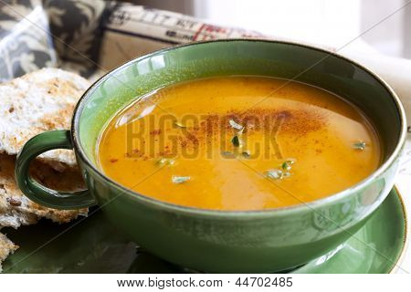 Pumpkin or squash soup with paprika, thyme, and toast.